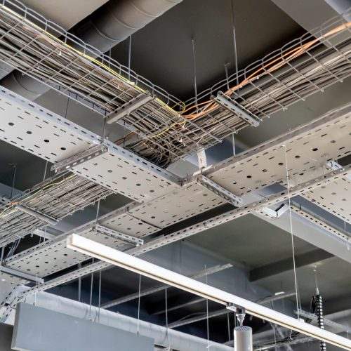 electric networks, cable trays, low-voltage networks of different colors on the ceiling